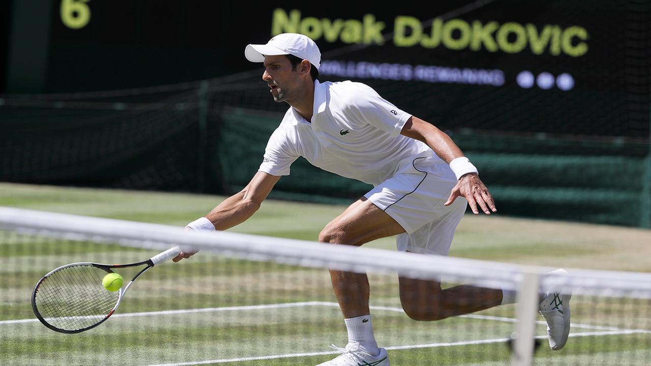 Serbias Novak Djokovic returns the ball to South Africas Kevin Anderson during the mens singles final match at the Wimbledon Tennis Championships. (AP Photo/Kirsty Wigglesworth)