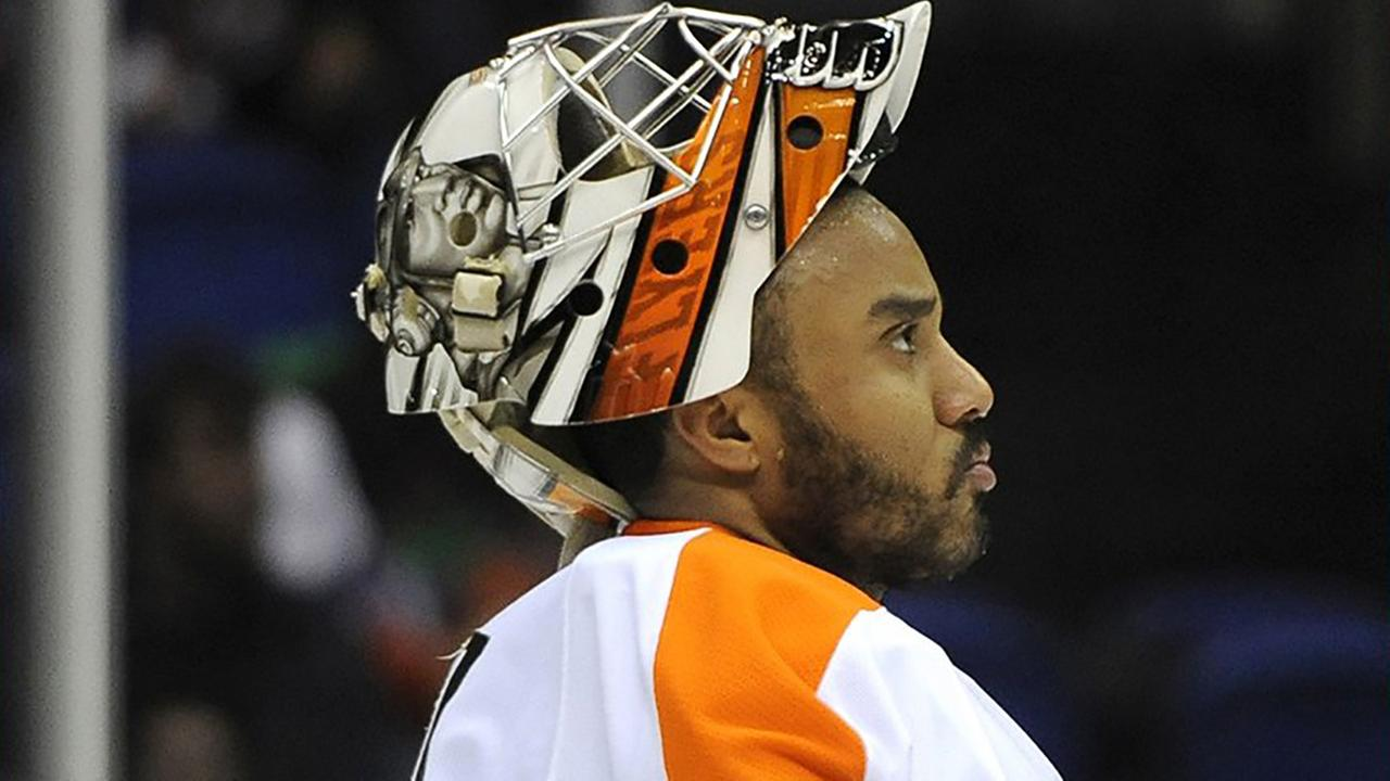 Philadelphia Flyers goalie Ray Emery awaits the start of the second period of an NHL hockey game against the New York Islanders on Monday, Jan. 20, 2014, in Uniondale, N.Y.