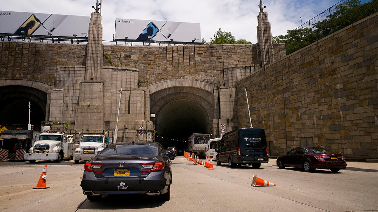 In this June 21, 2018, file photo, traffic on Route 495 enters the Lincoln Tunnel en route to New York City, in Weehauken, N.J. (AP Photo/Mark Lennihan, File)
