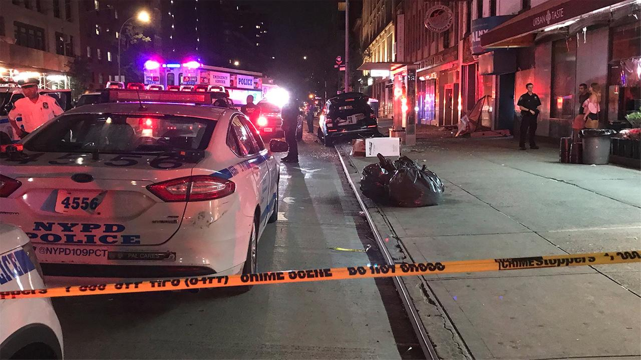 2 people critically injured after SUV jumps curb in Manhattan