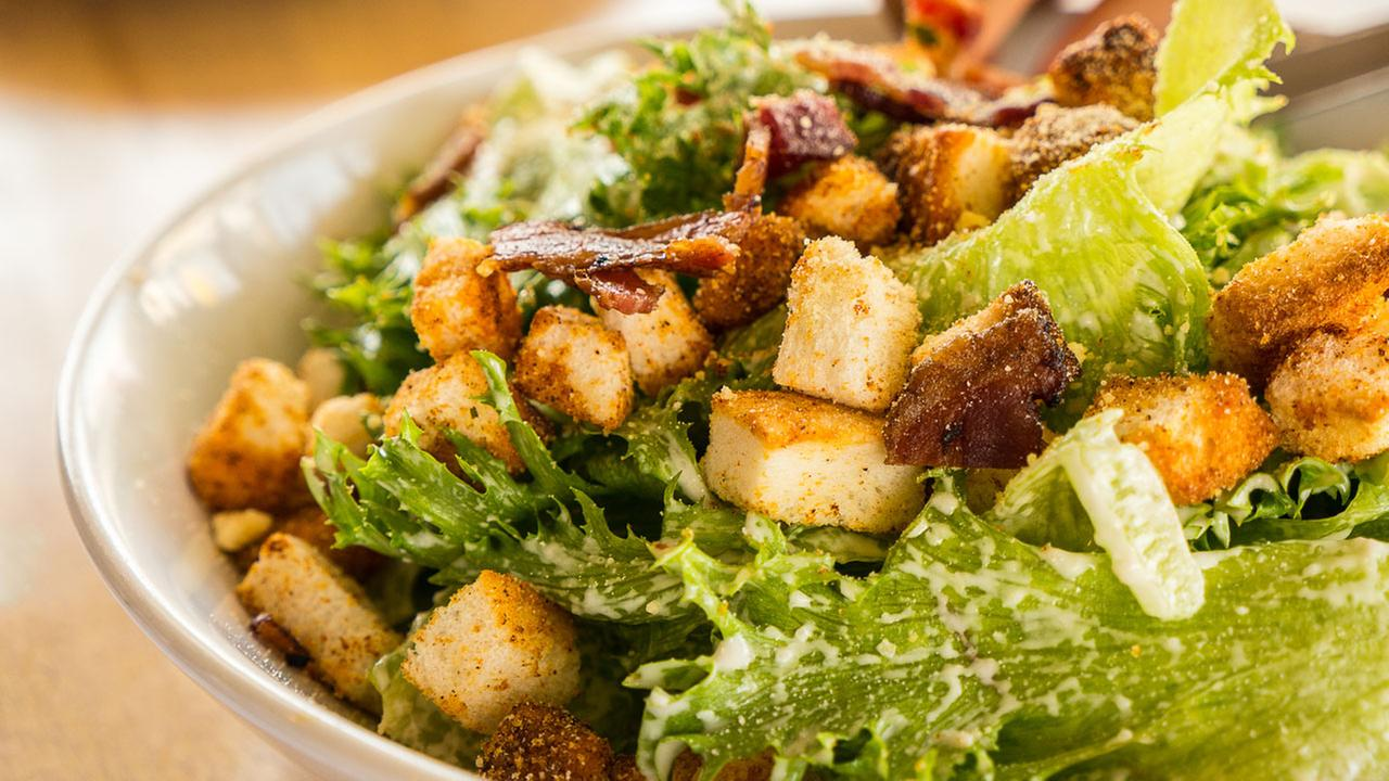 Stock image of a bowl of Caesar salad