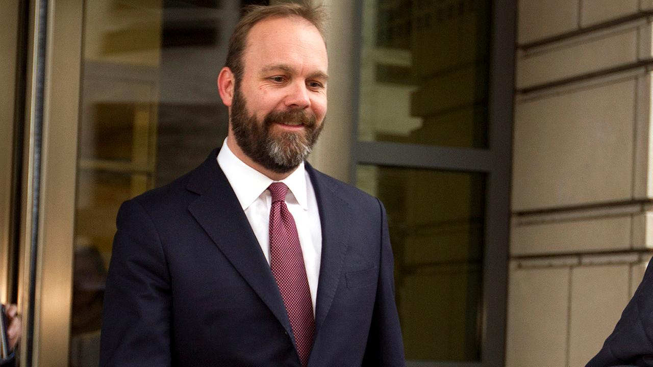 In this Feb. 23, 2018, file photo, Rick Gates leaves federal court in Washington.