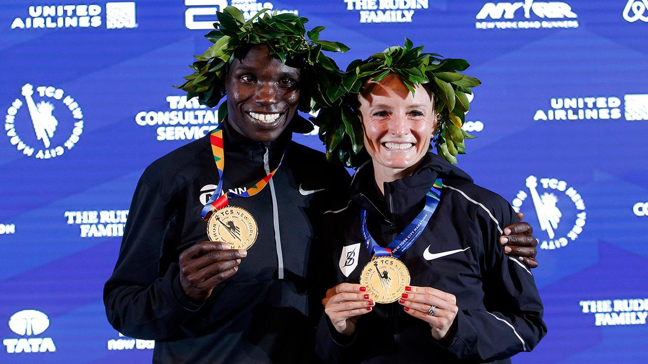 Mens race winner Geoffrey Kamworor, of Kenya, and womens race winner Shalane Flanagan, of the United States, pose together after the New York City Marathon, Nov. 5, 2017,