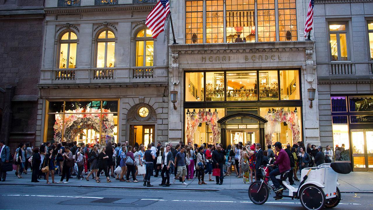 In this Sept. 8, 2011, file photo shoppers gather outside the Henri Bendel store on Fifth Avenue during Fashions Night Out in New York.