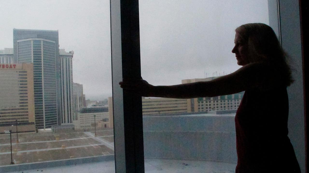 Mimi Razzi of Pawleys Island, S.C. looks out the window from her room at the Ocean Resort Casino in Atlantic City N.J. on Friday Sept. 14, 2018.