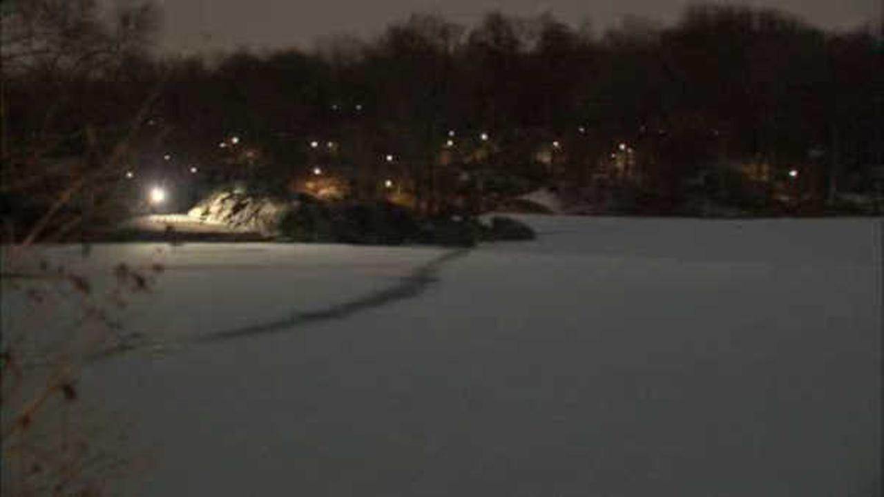 FDNY spot man walking across frozen lake while practicing cold water rescues
