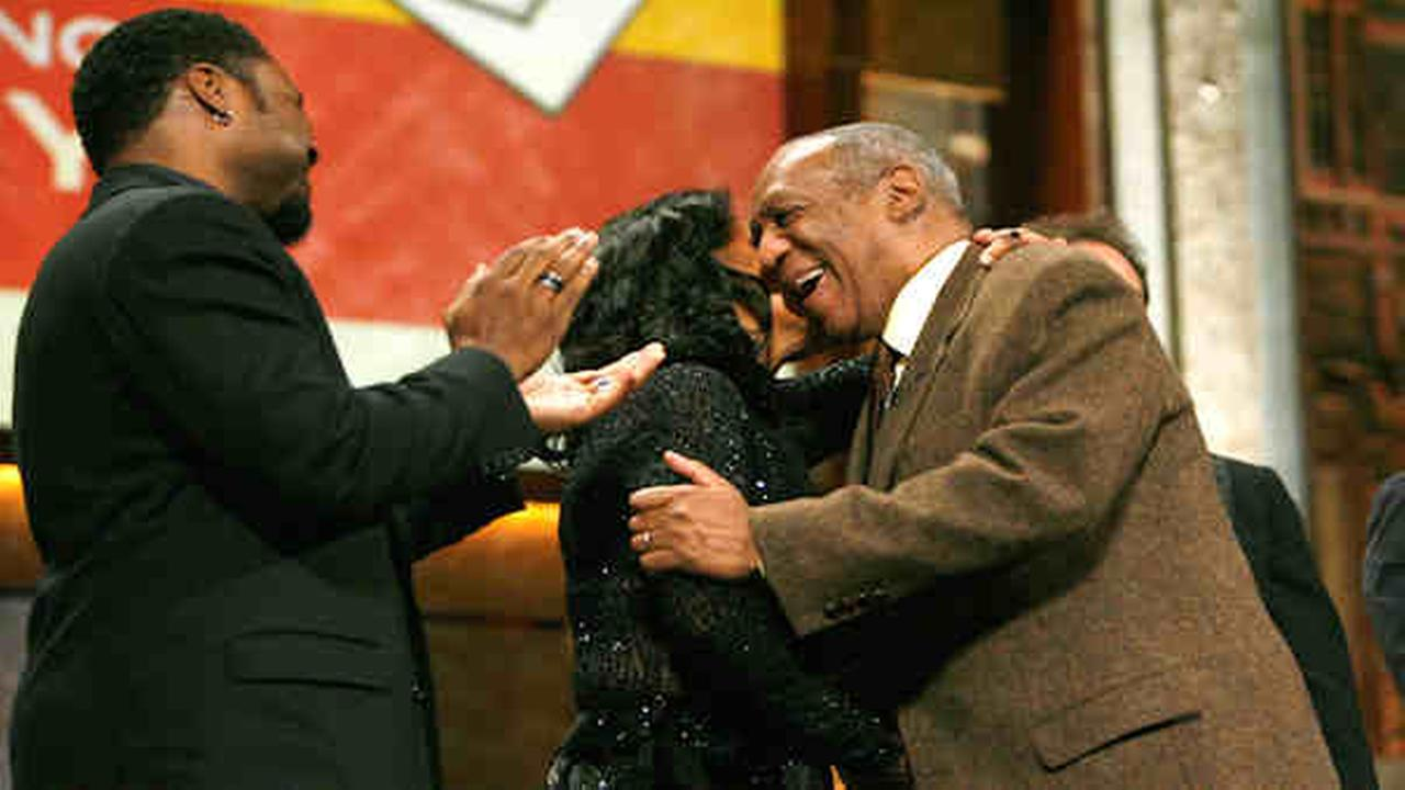 Comedian Bill Cosby, right, is congratulated by his TV co-stars from The Cosby Show, Malcolm-Jamal Warner, left, and Phylicia Rashad, after receiving the Mark Twain Prize for Ame