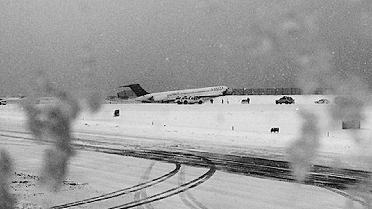 Plane skids off runway at LaGuardia, crashes through fence