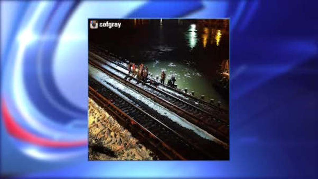 Rescuers pull woman from the Harlem River