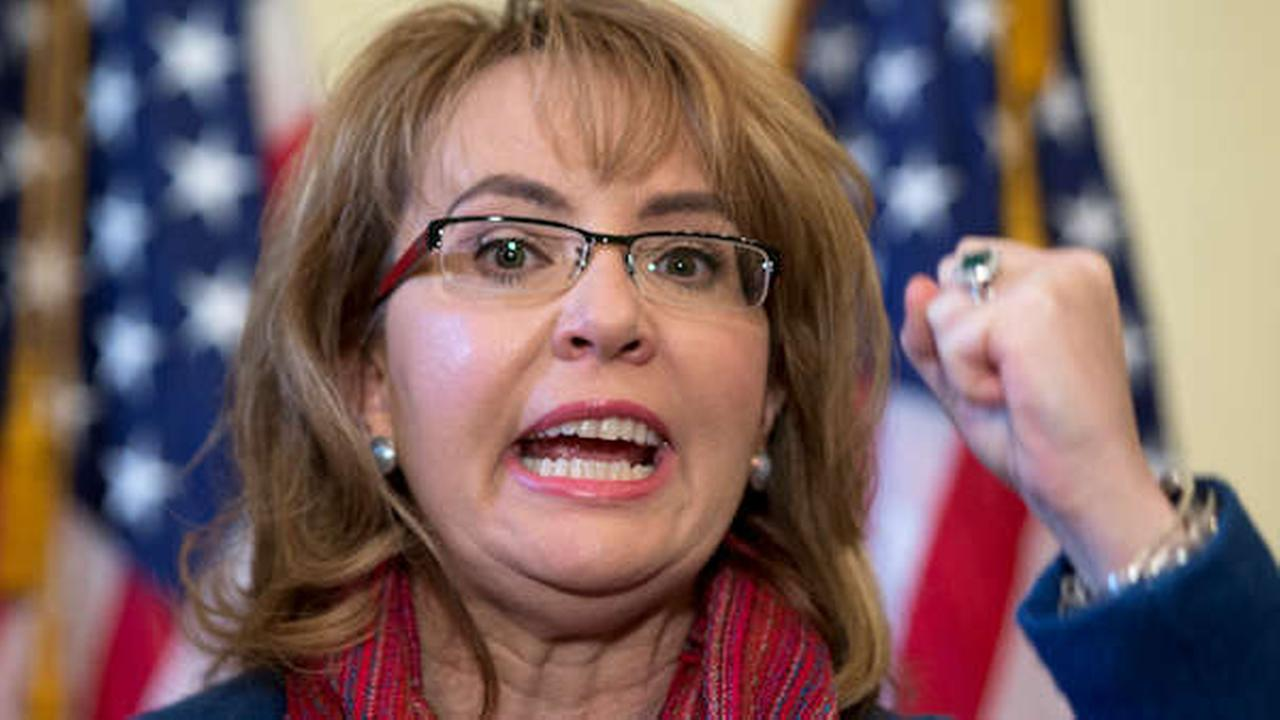 Former Arizona Rep. Gabby Giffords, D-Ariz. gestures as she speaks on Capitol Hill in Washington, Wednesday, March 4, 2015, about bipartisan legislation on gun safety