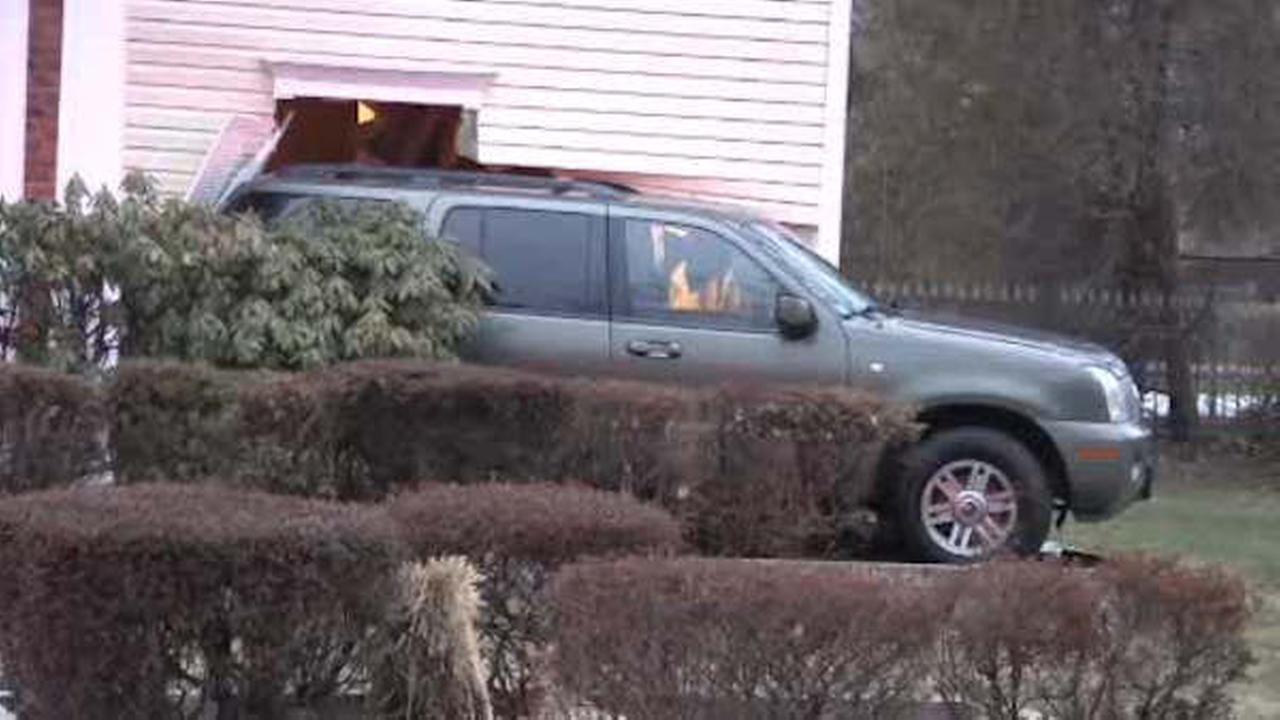 SUV slams into home on Long Island, narrowly missing family