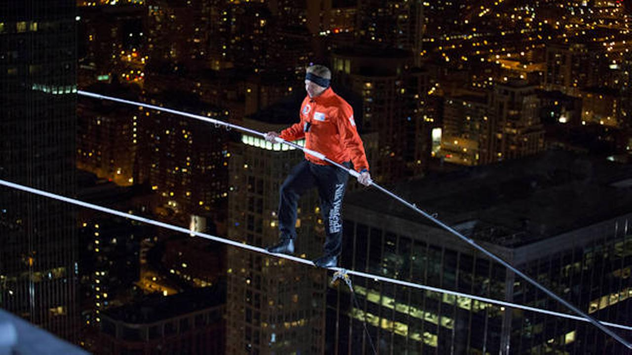 Nik Wallenda walks over the Chicago River uphill nearly 8 stories for Discovery Channels Skyscraper Live with Nik Wallenda on Sunday, Nov. 2, 2014.