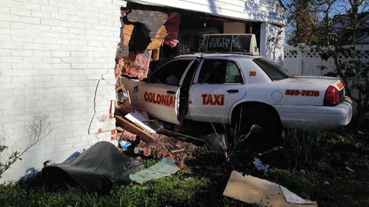 long island cab into house crash