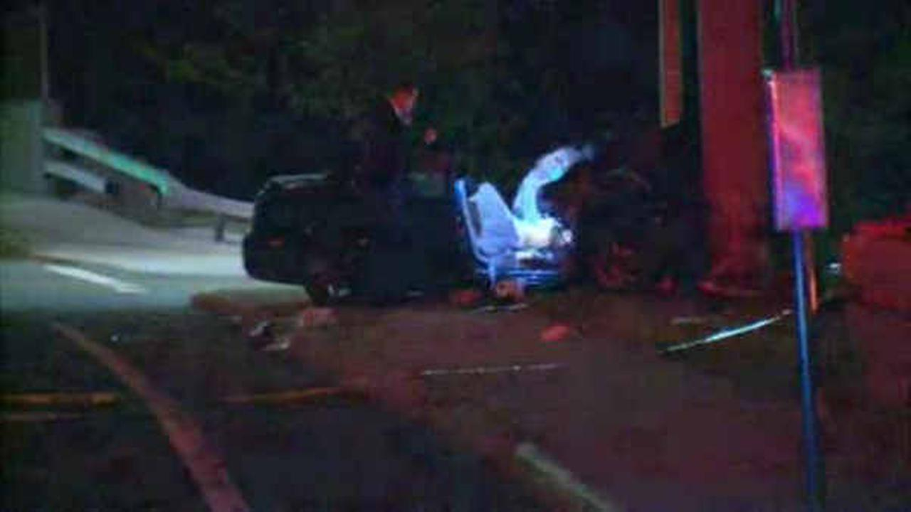 Car hits light pole exiting Belt Parkway, leaving 1 dead, 3 injured