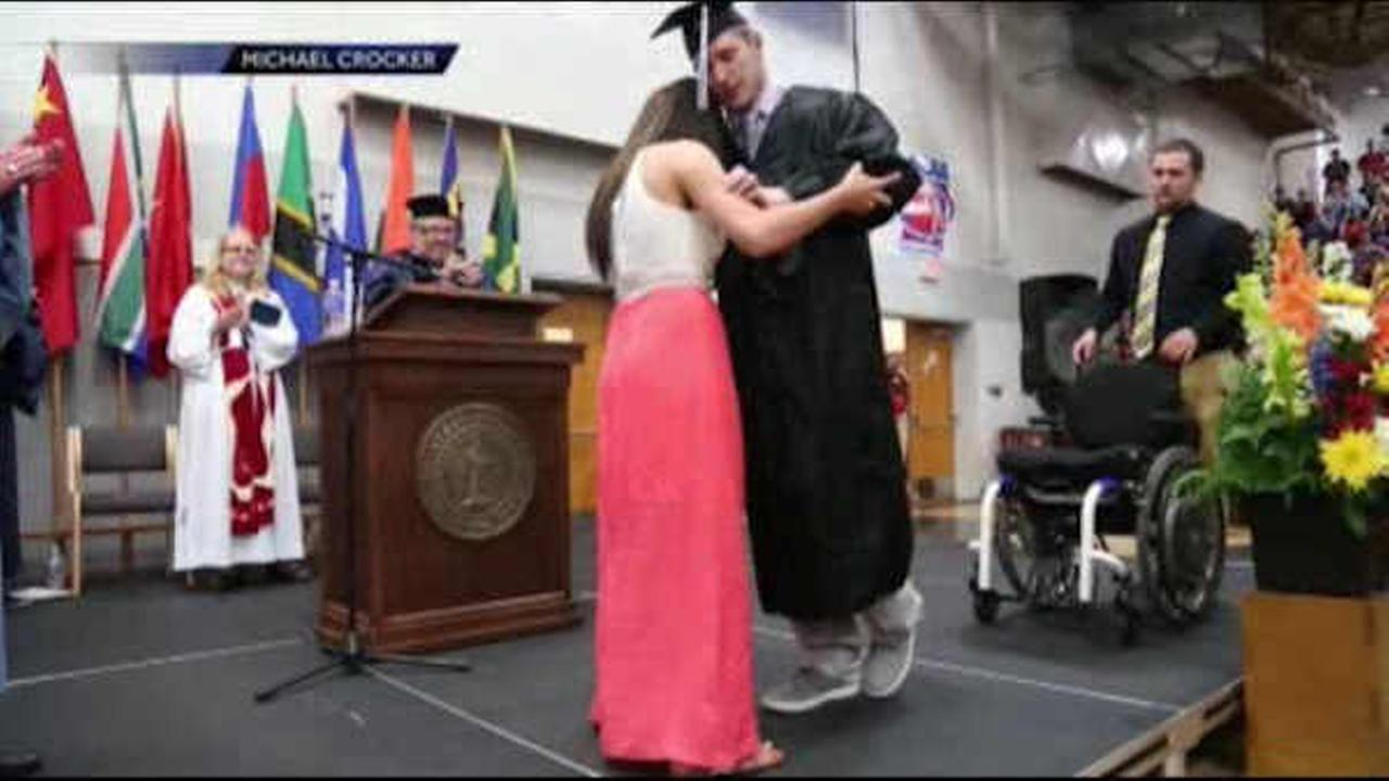 Young man paralyzed during football game walks at graduation, proposes