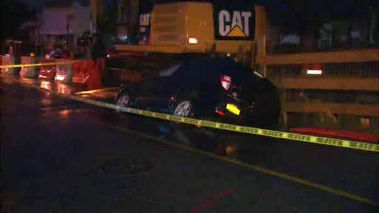 Sinkhole opens in Glendale, Queens, swallowing SUV on Cypress Avenue