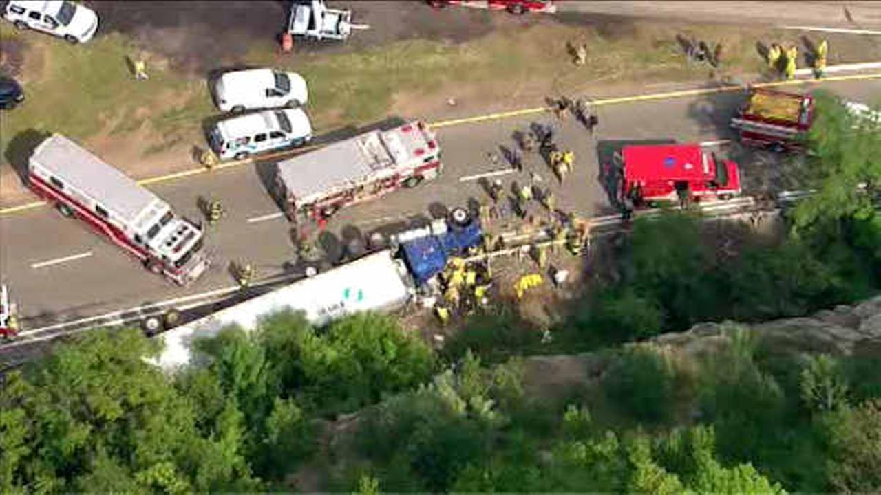 Tractor-trailer overturns on Route 287 in Mahwah; driver rescued