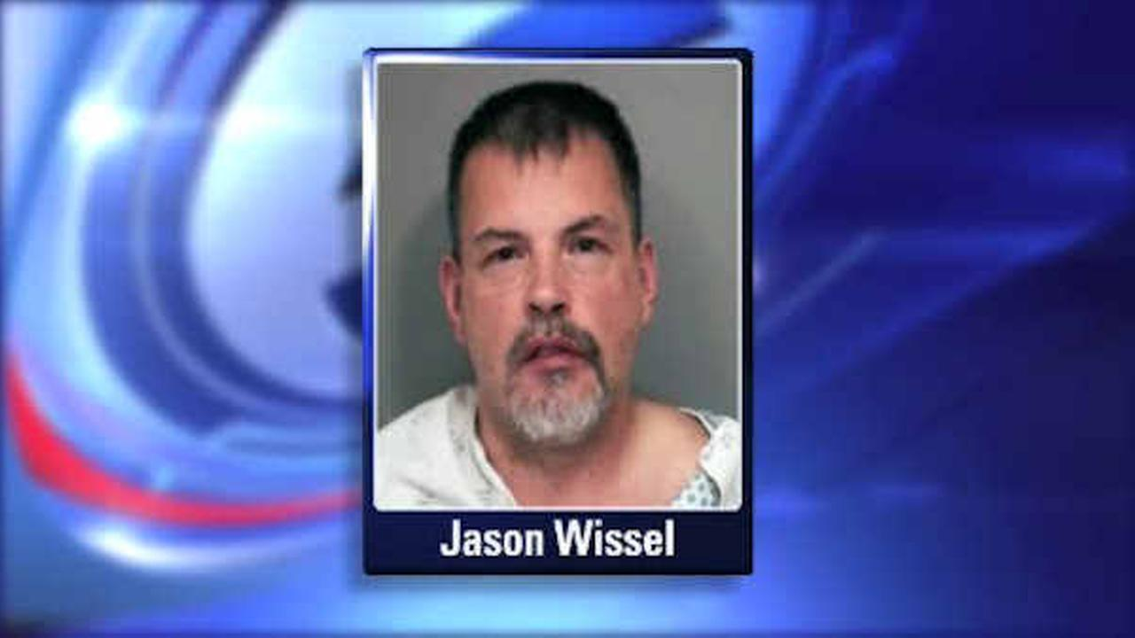 Man accused of pointing rifles at police officers in East Meadow