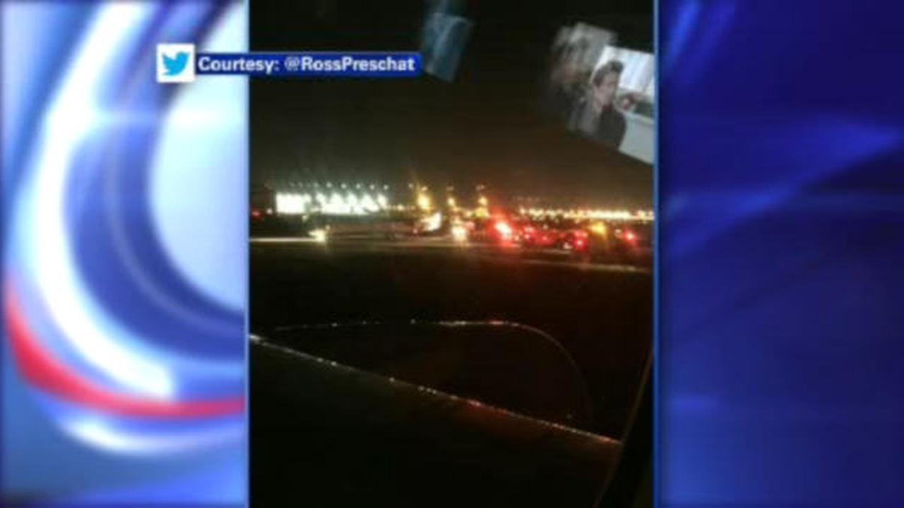 Fire crews respond to plane at Newark Airport after engine starts sparking