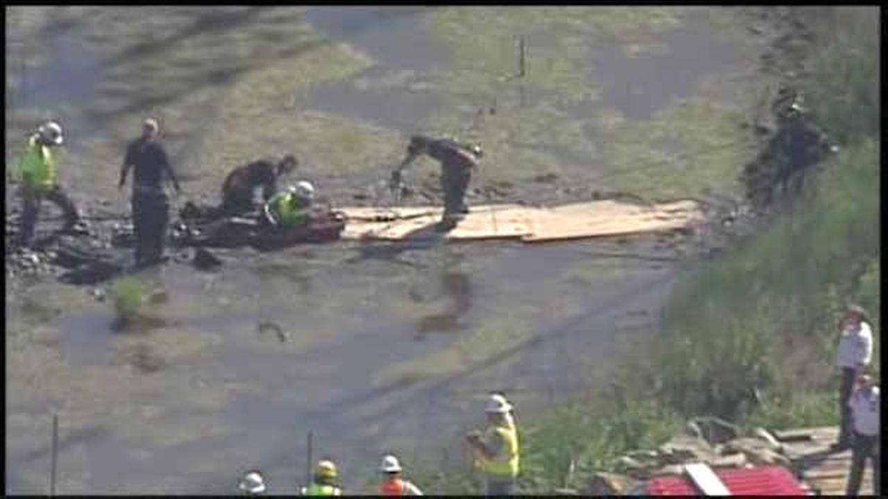 Rescuers free worker trapped in mud in North Arlington