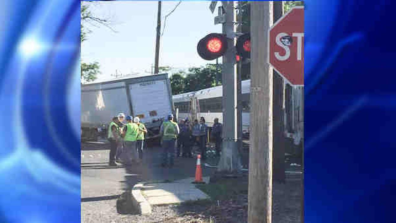 New Jersey Transit train hits tractor-trailer, delays service