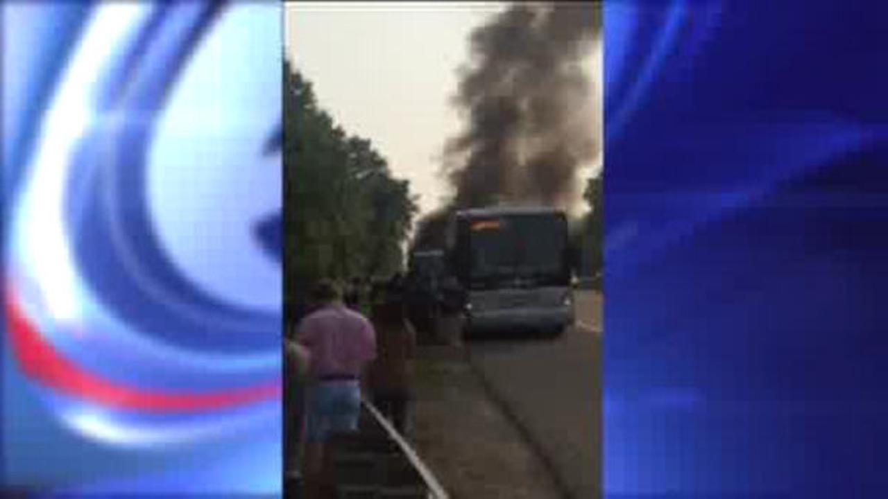 Tour bus bursts into flames on New Jersey Turnpike