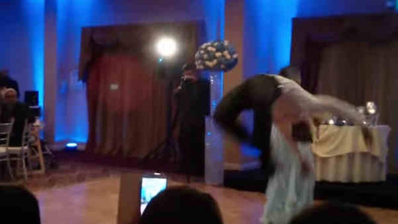Groomsman's backflip fail knocks out bridesmaid