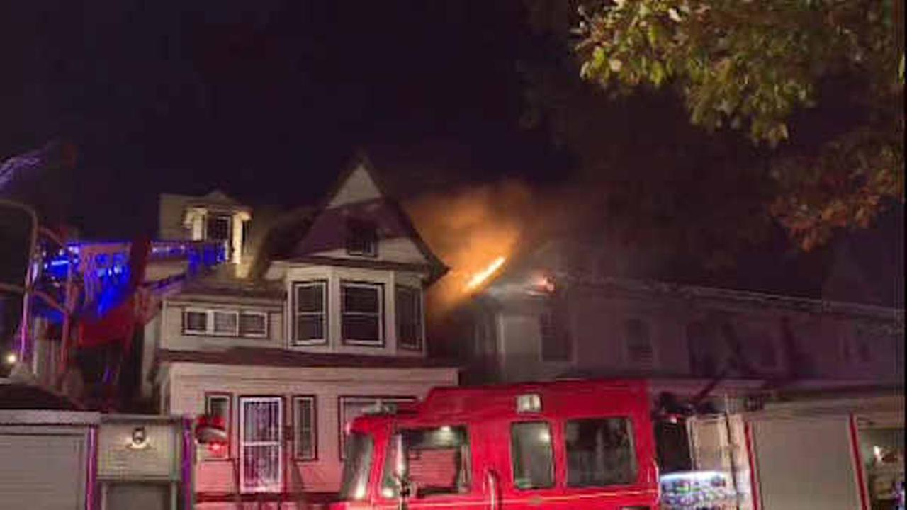 Firefighters battle East Orange house fire that spread to neighboring building