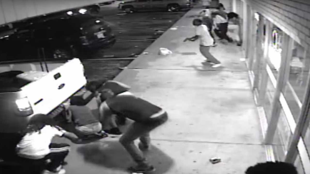 Police say surveillance video shows suspect grabbing gun before shooting in Ferguson