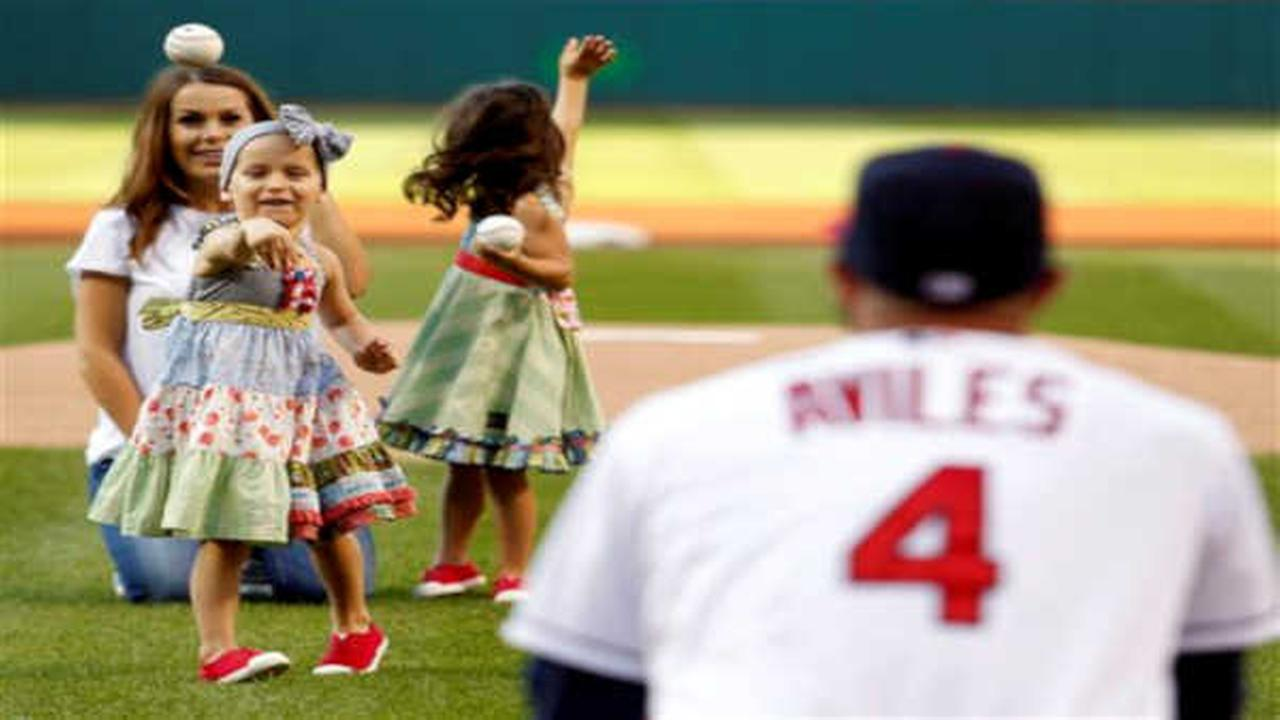 Indians infielder Mike Aviles' daughter throws out 1st pitch with sister amid leukemia fight