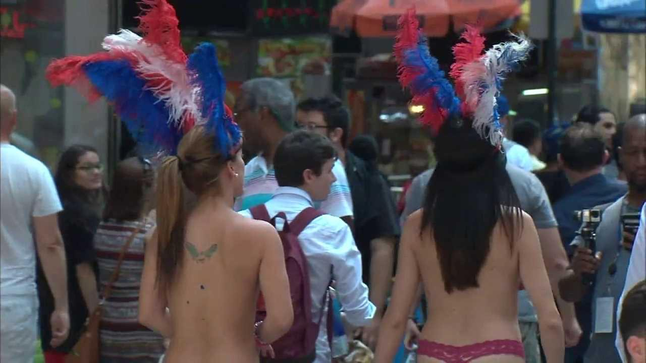 Two NYPD officers reassigned after taking photos with topless women in Times Square
