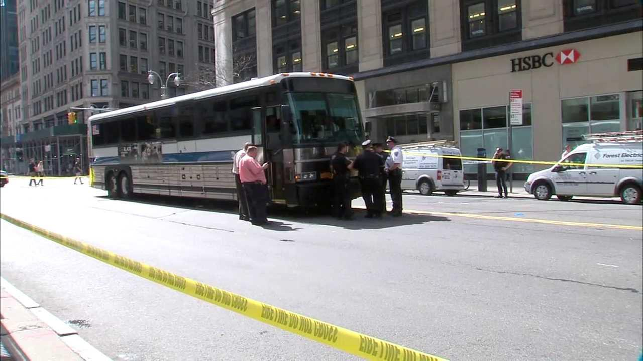 Woman crossing outside crosswalk fatally struck by MTA bus in Midtown