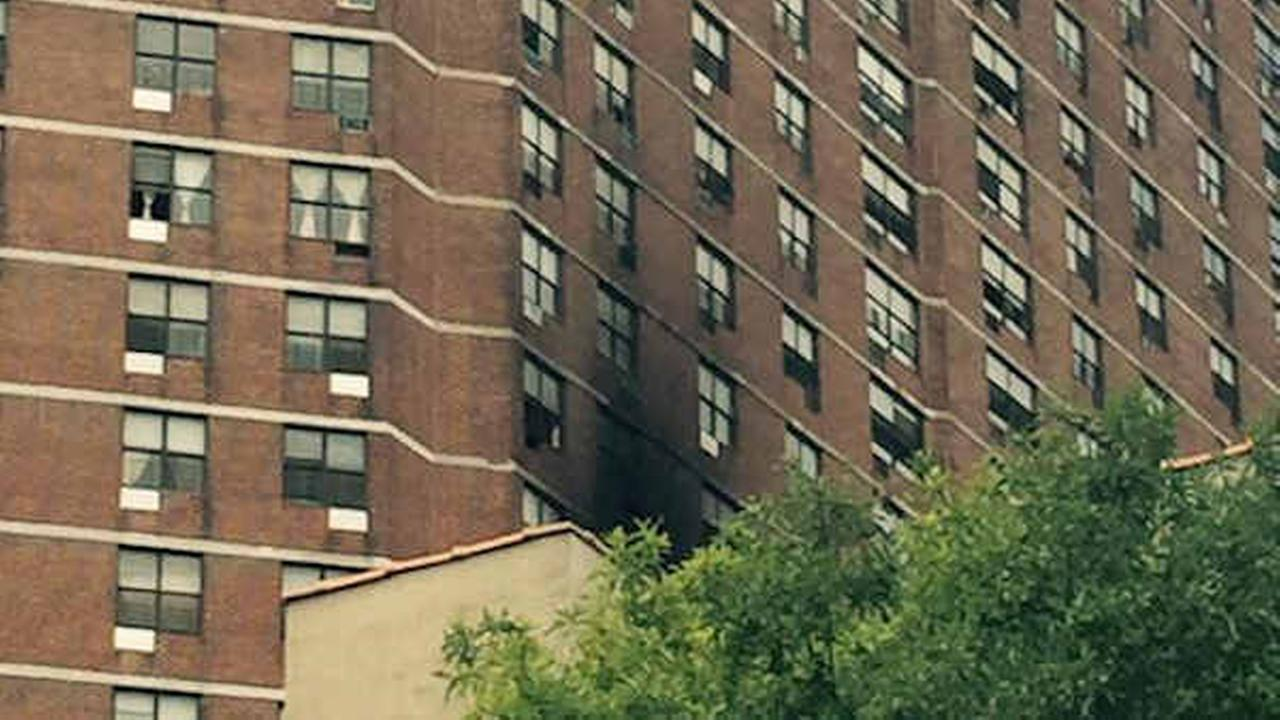 Firefighters battle 2-alarm fire at high-rise building in Harlem