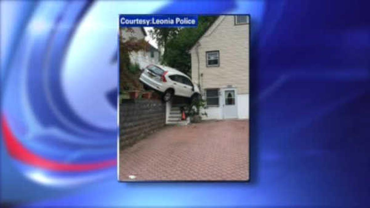 Driver injured after crashing into Leonia home