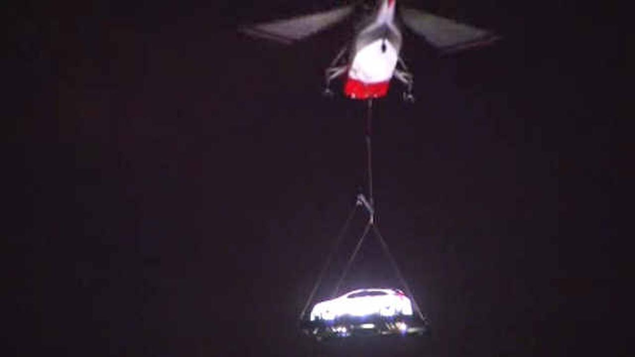 Helicopter suspends Cadillac over the West Side in high-flying publicity stunt