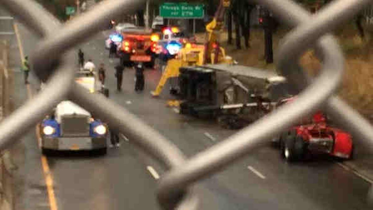 Tractor-trailer flips in Queens on LIE near Oceana Street