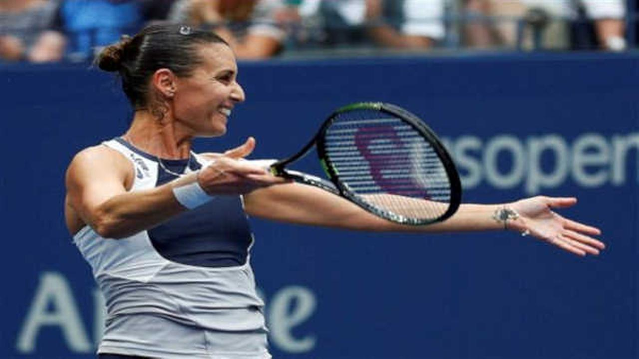 Italy's Flavia Pennetta wins US Open for 1st Slam title, says she'll retire