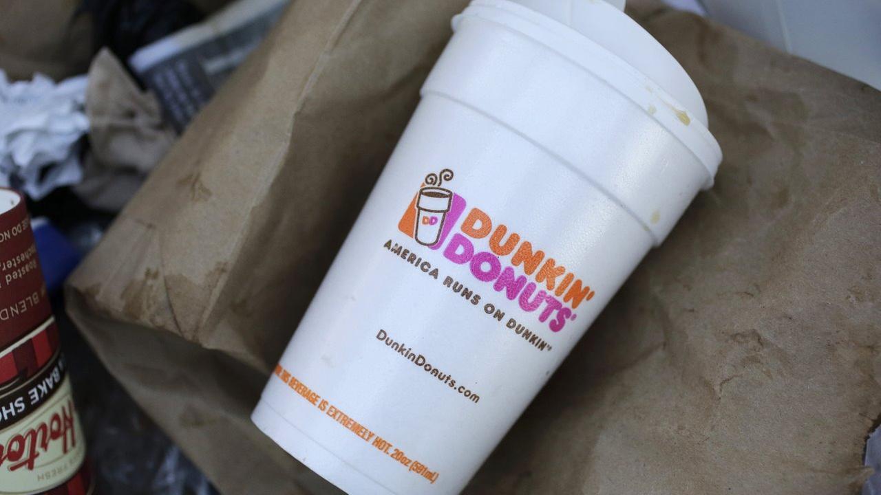 A Dunkin Donuts foam cup is discarded in a trash bin in New York Thursday, Feb. 14, 2013.