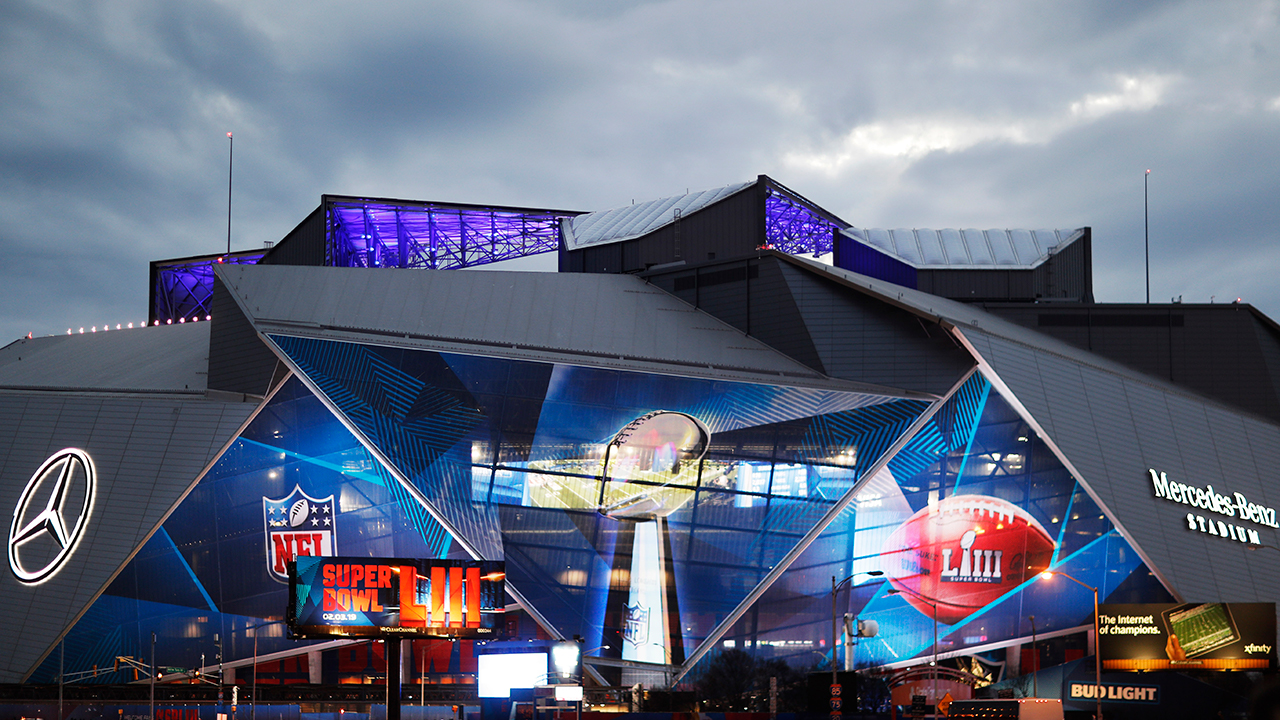 Mercedes-Benz Stadium is lit up ahead of Sundays NFL Super Bowl 53 football game between the Los Angeles Rams and New England Patriots in Atlanta, Saturday, Feb. 2, 2019.