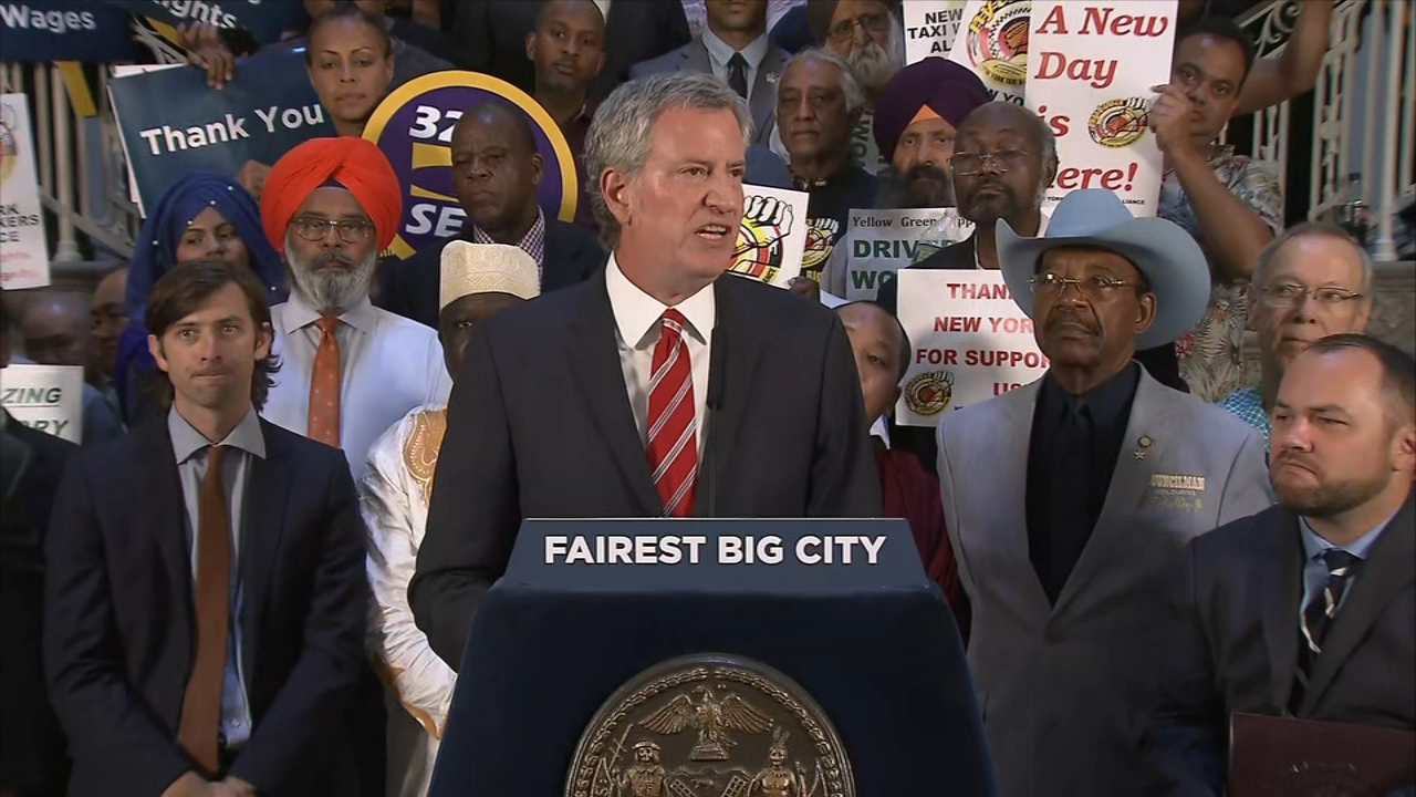 NYC Mayor Bill de Blasio spoke after signing the cap on ride-share vehicles into law