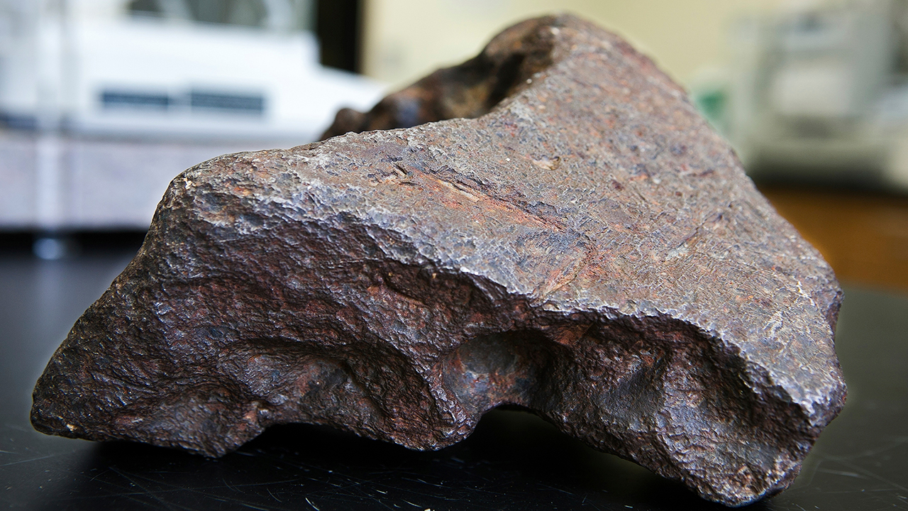 In this Sept. 14, 2018 photo provided by Central Michigan University, a 22-plus pound meteorite that was being used as a doorstop on a farm in Edmore, Mich., is shown.