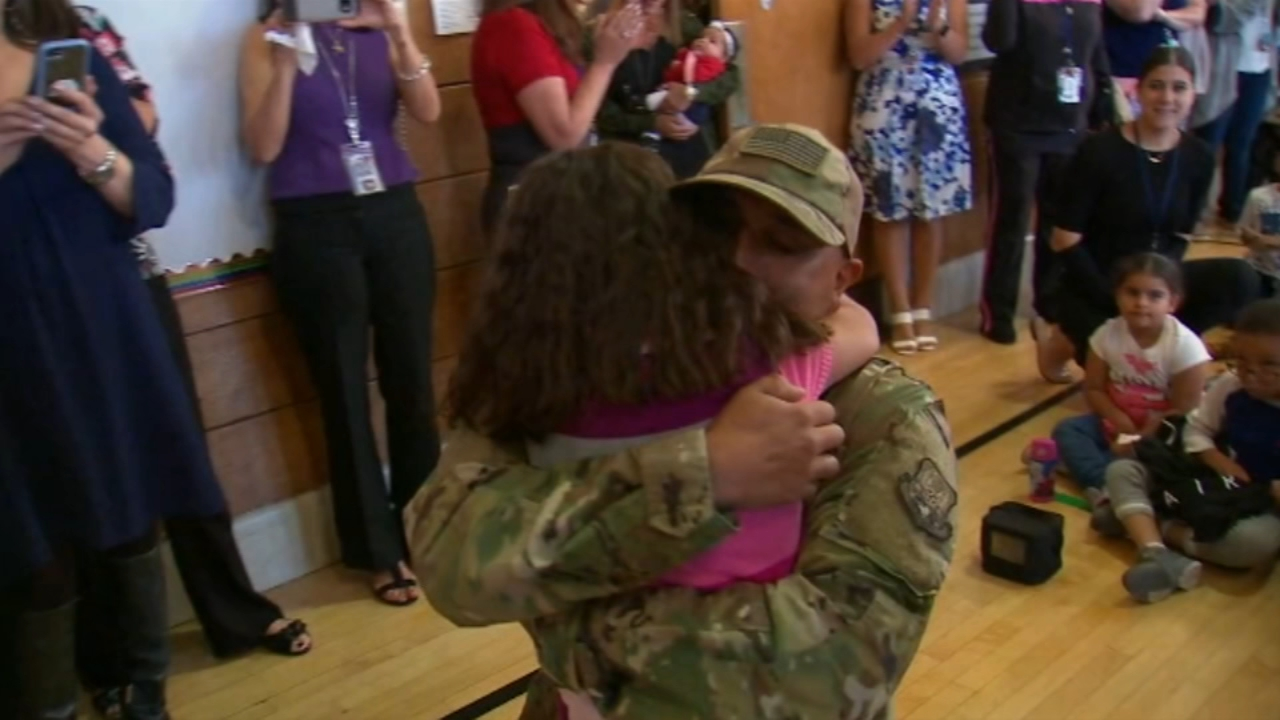 Students erupted in cheers as little Brooklyn Reyess jaw dropped the moment she saw her military father, who was previously deployed in Dubai, walk into her Long Island schools g