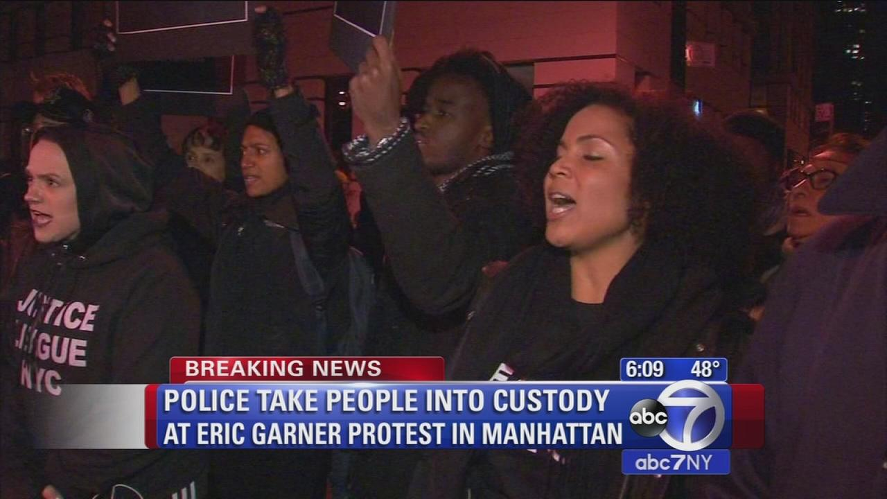 Police take people into custody at Eric Garner protest in Manhattan