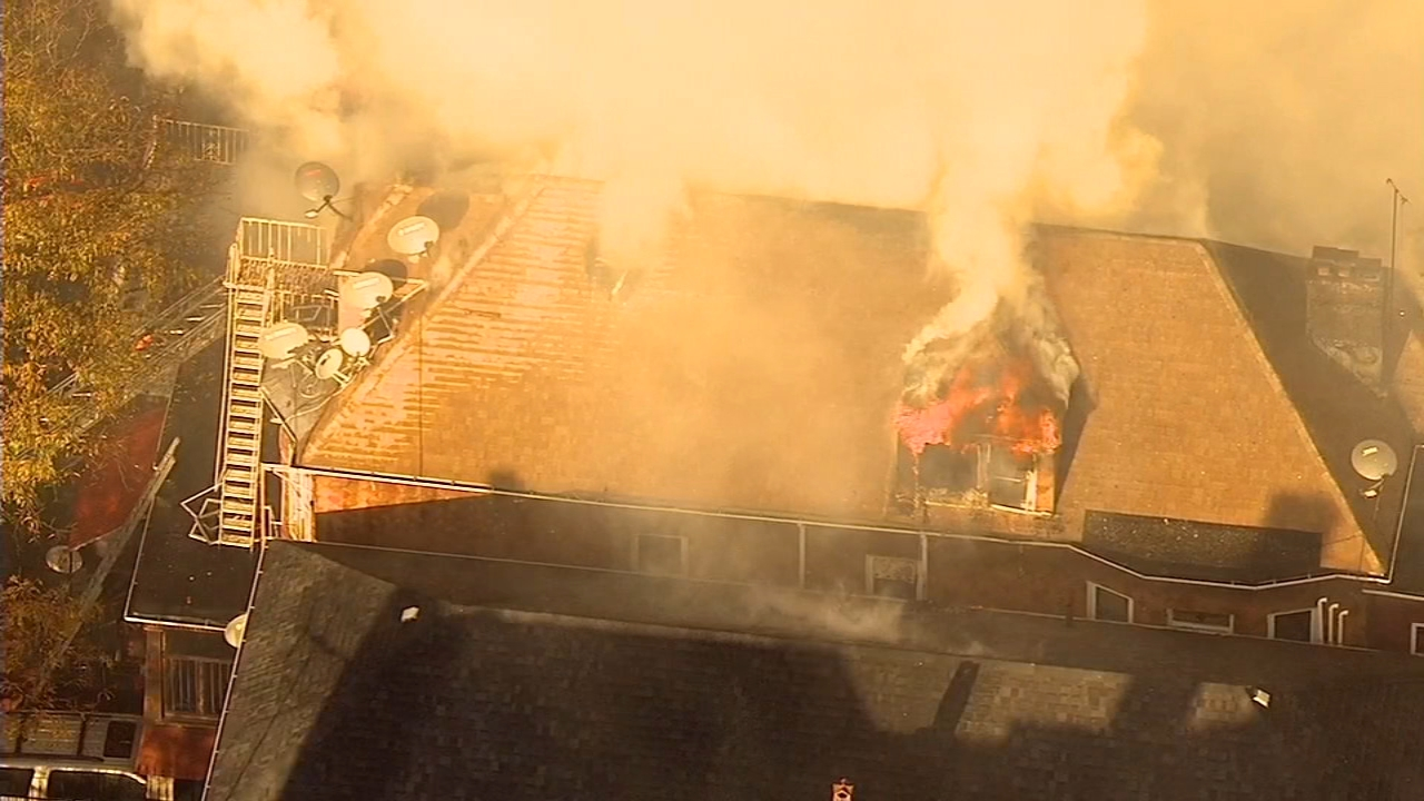 Flames burned through a three-story dwelling in the Bronx on Tuesday