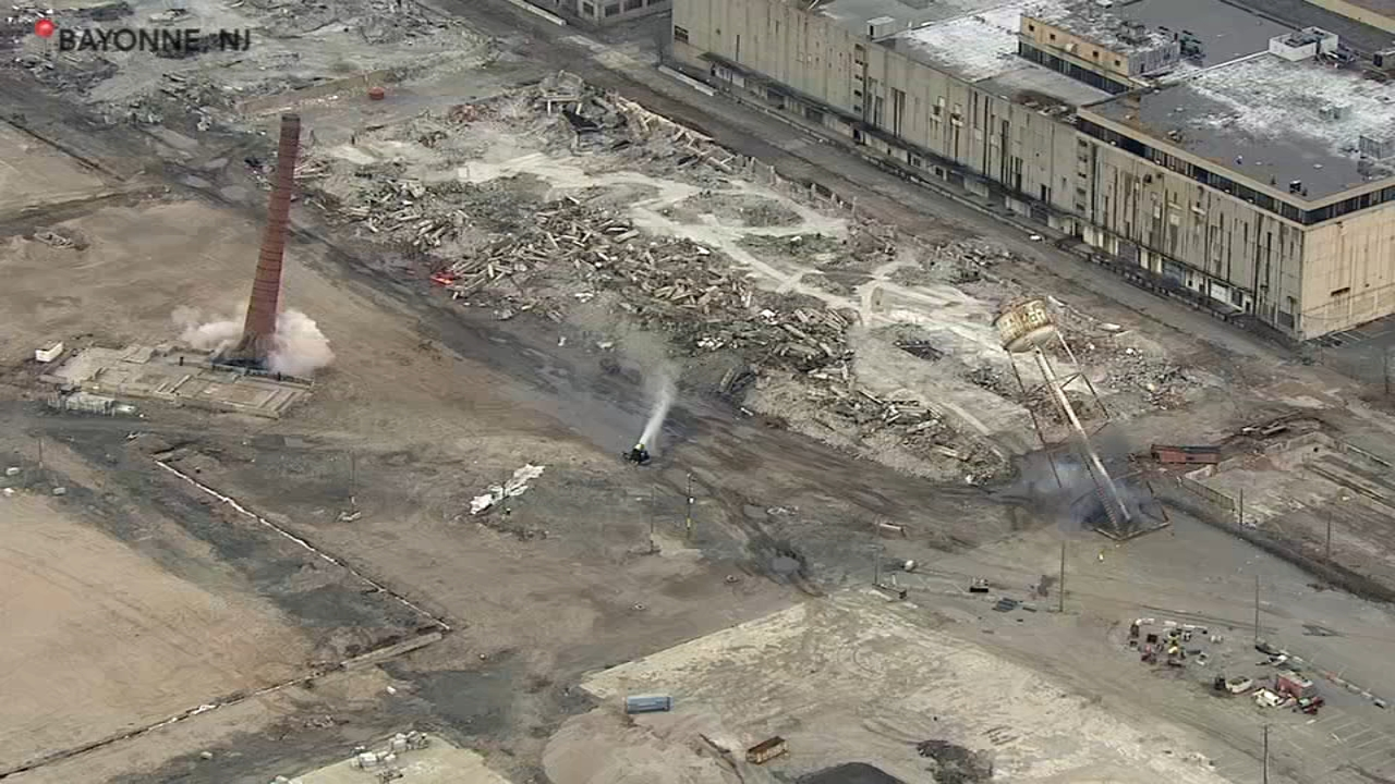 Demolition crews imploded a 175-foot smokestack and a 150-foot water tower in Bayonne, New Jersey on Friday.