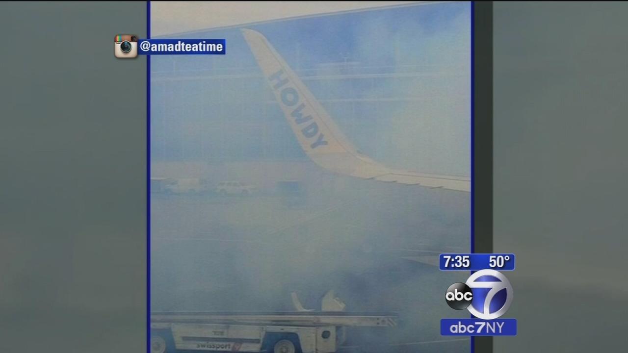 Flight evacuated at LaGuardia due to smoke