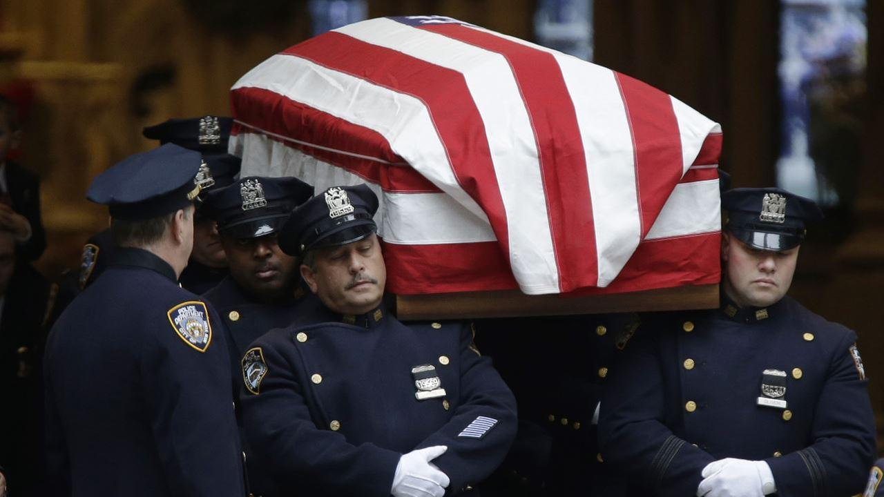 A casket containing the body of Joseph Lemm is carried out of St. Patricks Cathedral in New York, Wednesday, Dec. 30, 2015.