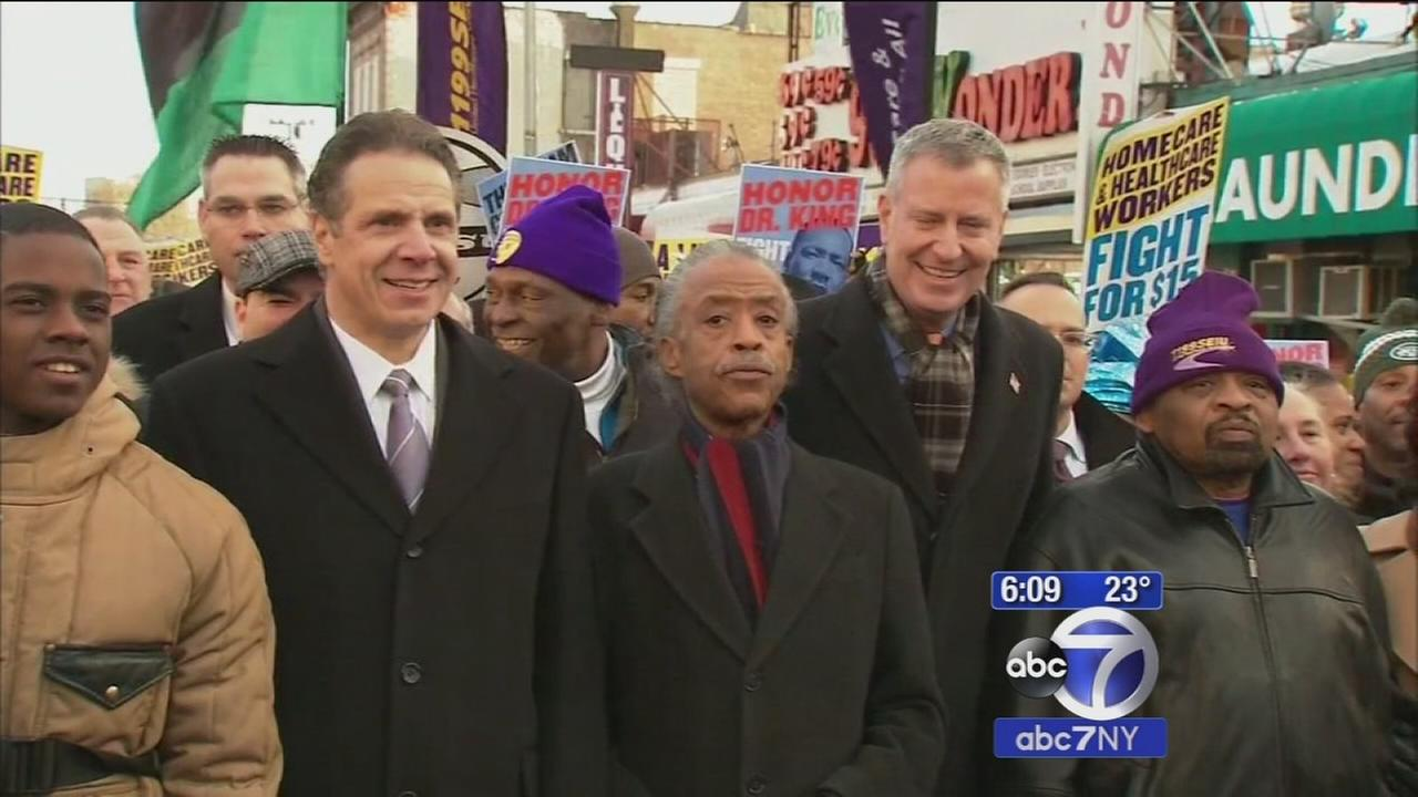 Mayor Bill de Blasio and Governor Andrew Cuomo march for minimum wage