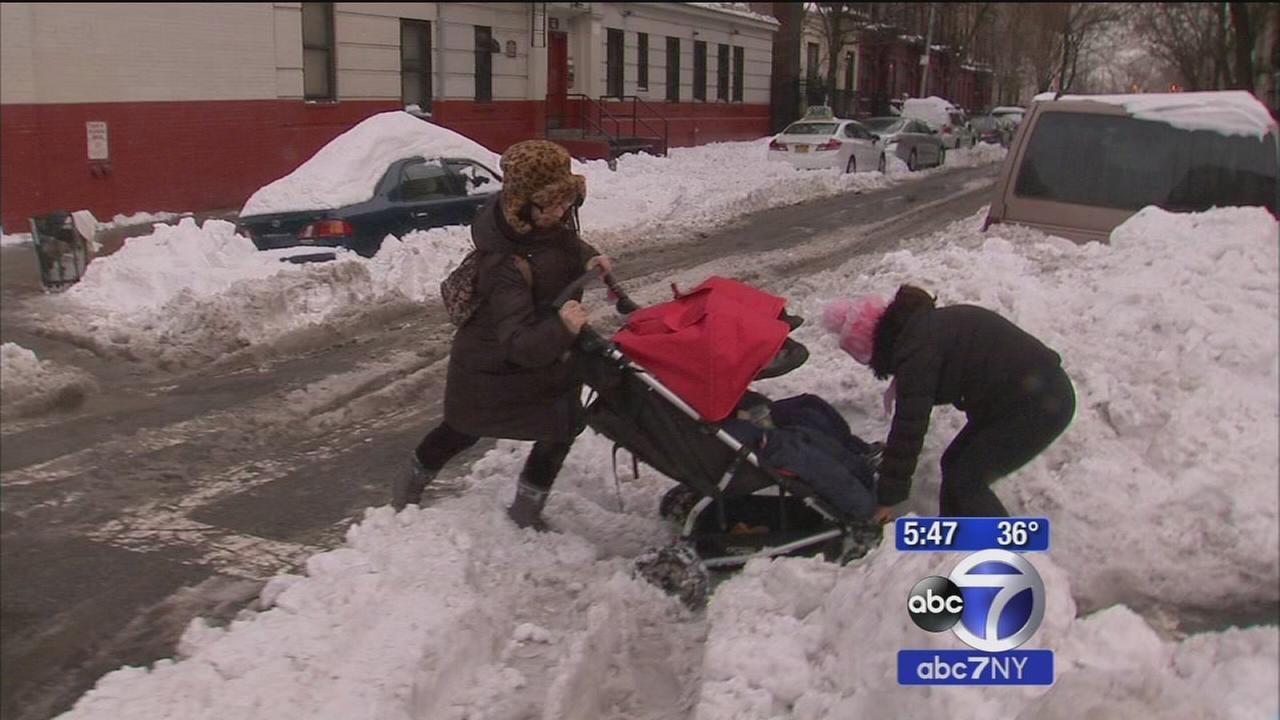 Snow covered streets create obstacle course for pedestrians