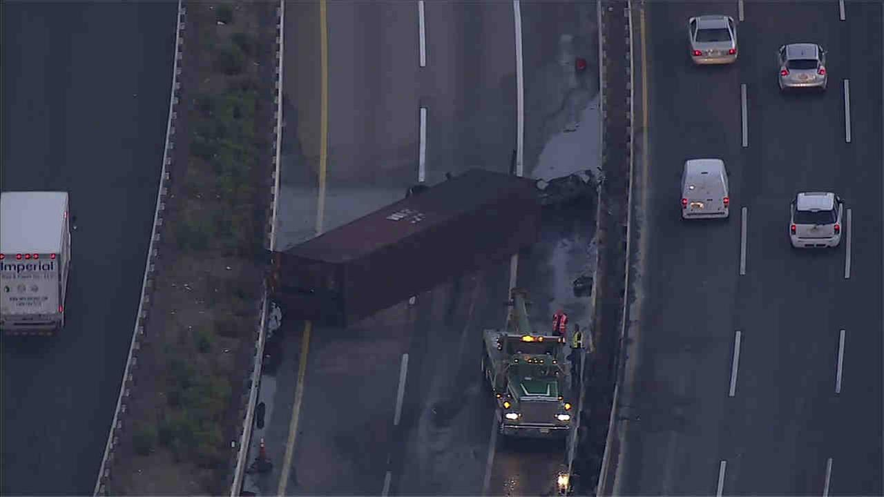 A tractor-trailer overturned and caught fire on the New Jersey Turnpike in Ridgefield Park.